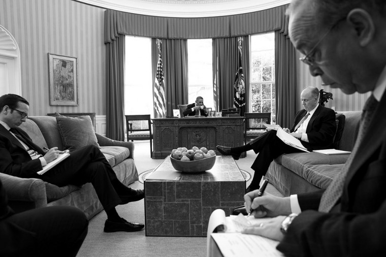 "March 14, 2013 ""The President sips a cup of tea while talking on the phone in the Oval Office with President Xi Jinping of China. I converted the digital file to black and white to accentuate the three presidential aides in the foreground."" (Official White House Photo by Pete Souza)"