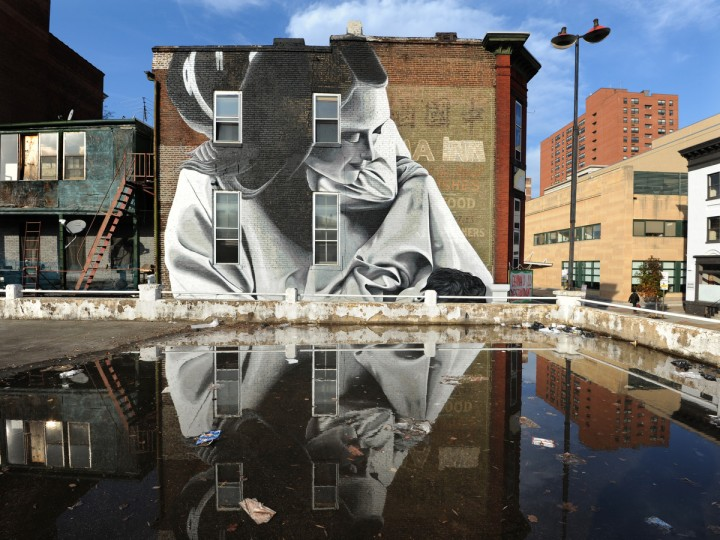 The mural of mother and child by the artist Indigo covers the side facade of 406 Park Avenue and was part of the Articulate: Baltimore project. (Algerina Perna/Baltimore Sun)