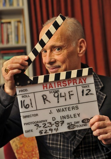 "On January 15, 2013, John Waters, filmmaker and writer, holds the slate used during the final scene while filming the movie ""Hairspray."" He will be narrating ""Hairspray in Concert!"" with the Baltimore Symphony Orchestra from Jan. 24 to 27. It's the 25th anniversary of his original film version of Hairspray. (Amy Davis/Baltimore Sun)"