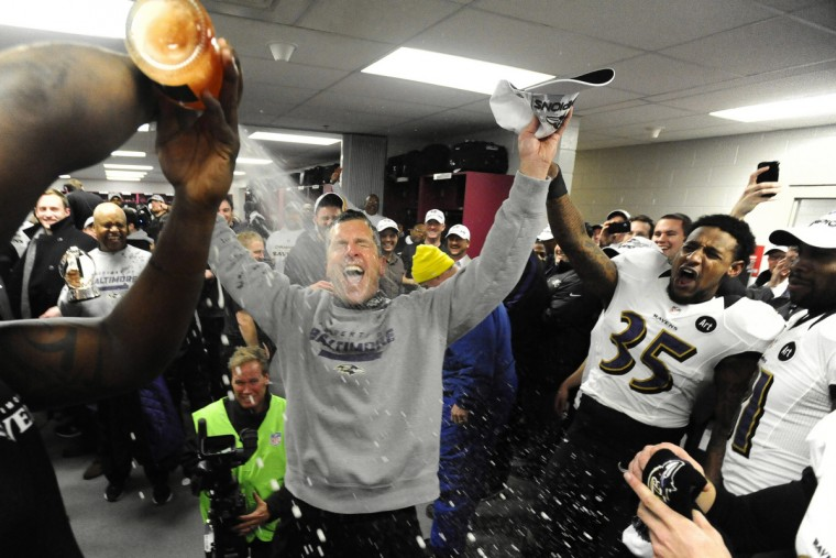 Ravens head coach John Harbough gets sprayed with champagne in the locker room after winning AFC Championship on January 20, 2013. The Ravens defeated the New England Patriots in the AFC Championship game to advance to the Super Bowl. (Kenneth K. Lam/Baltimore Sun)