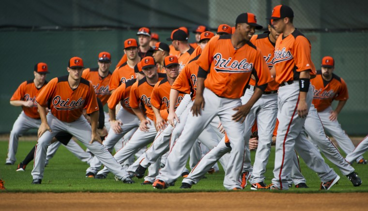 The Orioles pitchers and catchers stretch and warm up as a group on February 14, 2013 during workouts in Sarasota, Florida on the second day of Spring Training. (Christopher T. Assaf/Baltimore Sun)