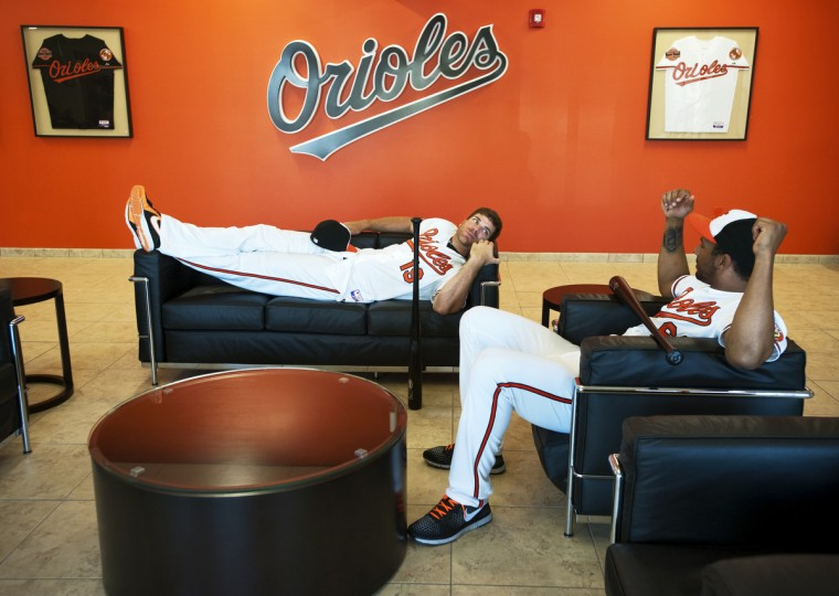 Orioles first baseman Chris Davis, left, and outfielder Chris Dickerson lounge in the lobby of the Orioles baseball complex waiting for their turn with the team's video crew during photo day on February 22, 2013. (Christopher T. Assaf/Baltimore Sun)