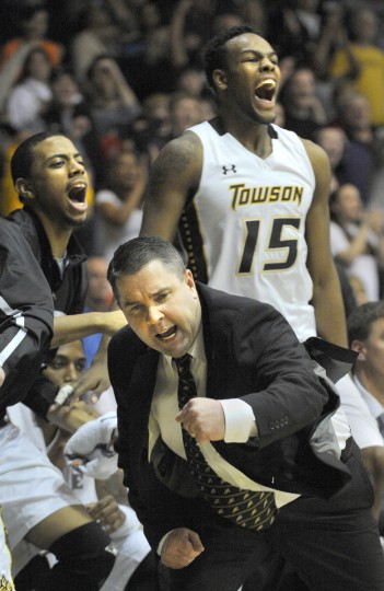 Towson University head basketball coach Pat Skerry, foreground, reacts after Towson scores late in the game. This was the last men's game to be played in the Towson Center. (Lloyd Fox/Baltimore Sun)