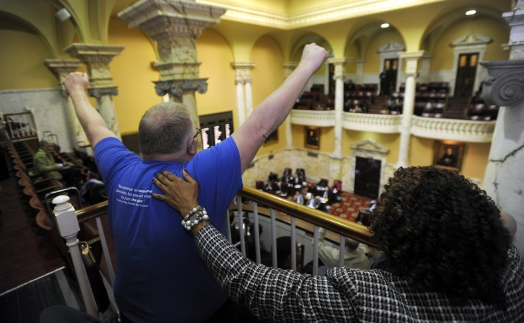 On March 6, 2013, in the Senate chamber gallery, Kirk Bloodsworth, left, who spent several years on Maryland's death row for a crime he did not commit, reacts with joy when the Senate votes to end the death penalty in Maryland. This week marks the 28th anniversary of Bloodsworth's wrongful conviction for the murder of Dawn Hamilton. He was sentenced to death, but was later exonerated by DNA evidence. (Barbara Haddock Taylor/Baltimore Sun)