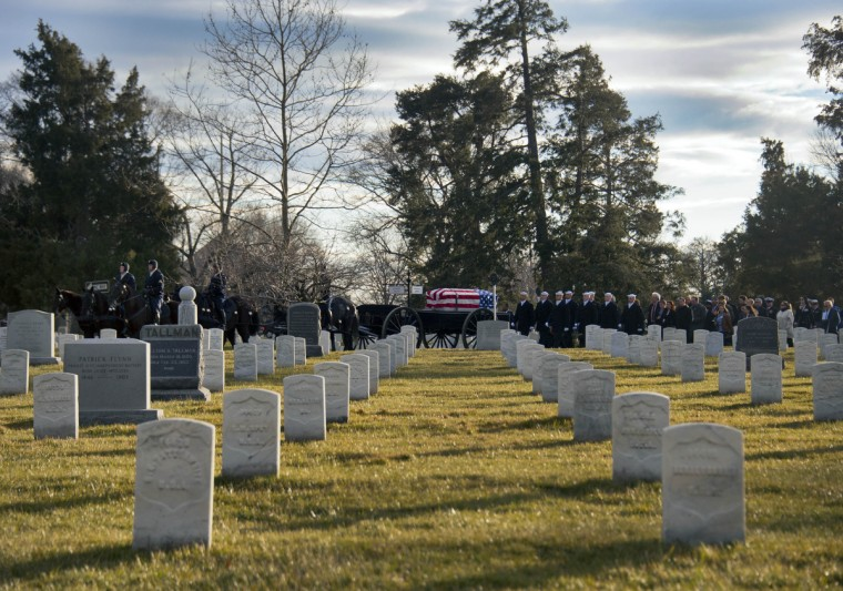 A caisson bearing one of two caskets moves slowly among graves of Civil War dead (in foreground) during an interment service for two sailors at Arlington National Cemetery Friday, March 8, 2013. The two were recovered at the site of the USS Monitor, the first-ever iron-clad vessel that fought in the Civil War. She sank in a storm December 31, 1862, and 16 of her crew were lost.(Karl Merton Ferron/Baltimore Sun)