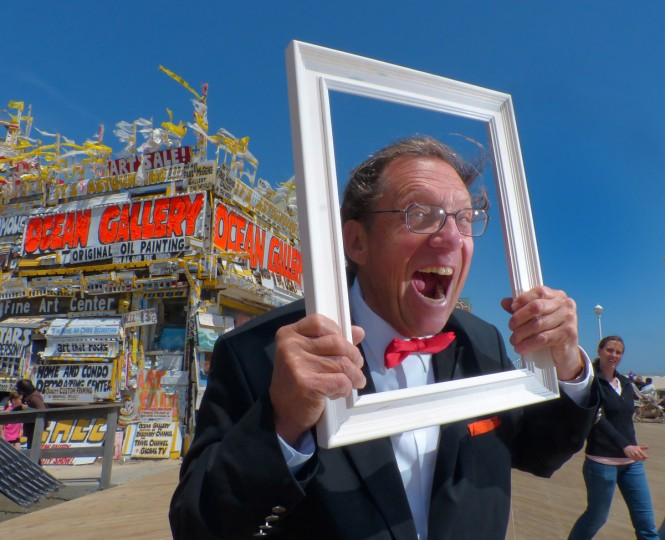 Joe Kro-Art poses outside his store in Ocean Gallery, celebrating its 50th year on the Boardwalk, May. 4, 2013. (Karl Merton Ferron/Baltimore Sun)