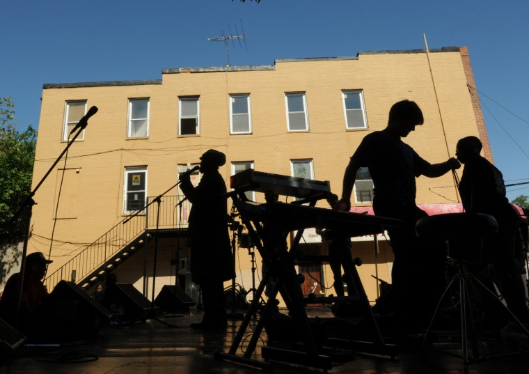 J. Pope and Funk Friday and technicians set up on May 26, 2013 for their performance at The Sowebo Arts and Music Festival which took place today in the 1100 block of Holins St. and surrounding streets. At far right is J. Pope. (Algerina Perna/Baltimore Sun)