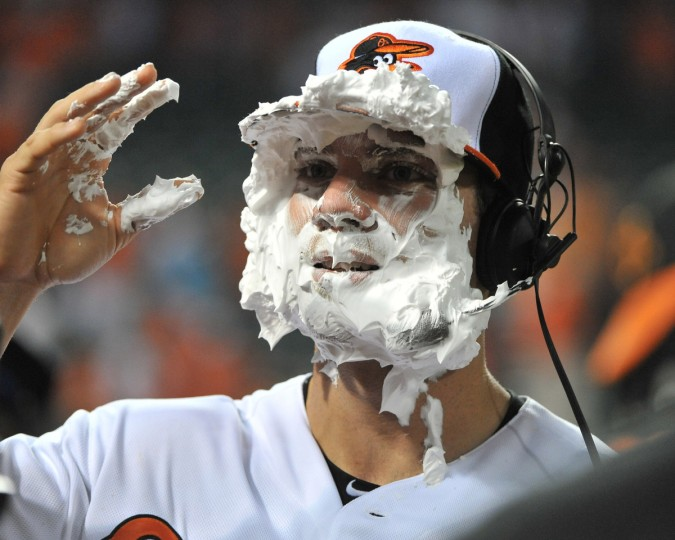 "Orioles Chris Davis tries to get his eyes clear of a shaving cream ""pie"", after he was pelted by Adam Jones and Chris Dickerson. Davis had two home runs resulting in 3 RBI's on May 29, 2013. (Gene Sweeney Jr./Baltimore Sun)"