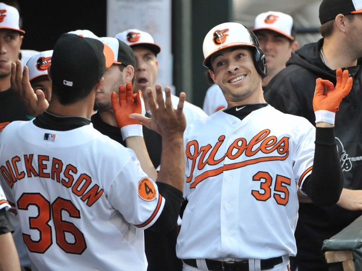 Orioles's #35 Danny Valencia, right, has fun with teammate Chris Dickerson, after his (Valencia) solo home run in the 3rd inning on June 13, 2013 in a game against the Boston Red Sox. (Gene Sweeney Jr./Baltimore Sun)