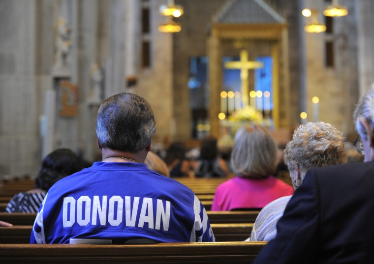 A fan wears a Donovan jersey to the funeral services for the Hall of Fame Baltimore player. The funeral of Arthur James Donovan Jr. the former Baltimore Colts football player was held at the Cathedral of Mary Our Queen in Baltimore on August 9, 2013. (Lloyd Fox/Baltimore Sun)