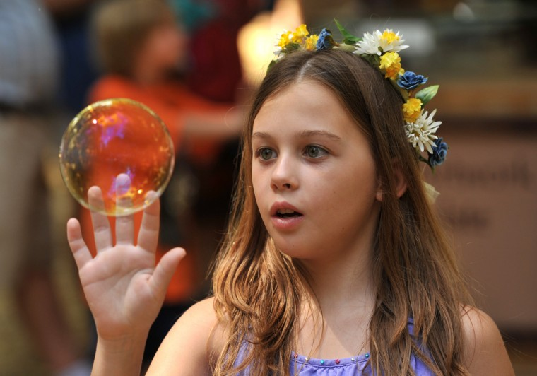 Olivia Clayton, 9, of Odenton, follows a bubble at the Maryland Renaissance Festival, on August 25, 2013, now in its 37th season. (Amy Davis/ Baltimore Sun)
