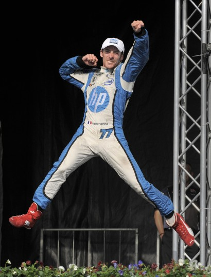 Indy Car winner Simon Pagenaud celebrates his victory in the winner's circle of the Grand Prix of Baltimore on September 1, 2013. (Lloyd Fox/Baltimore Sun)