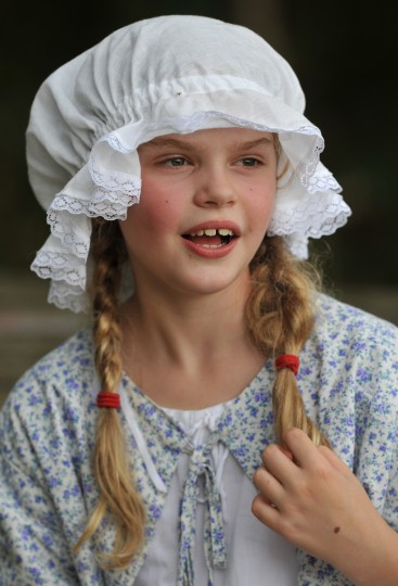 Veronica Dean, 8, of Manassas, Va., participated in period costume with her family at the Defenders Day reenactment of the Battle of North Point at Fort Howard Park on September 8, 2013. Her father, Robert Dean, was one of the defenders. (Amy Davis / Baltimore Sun)