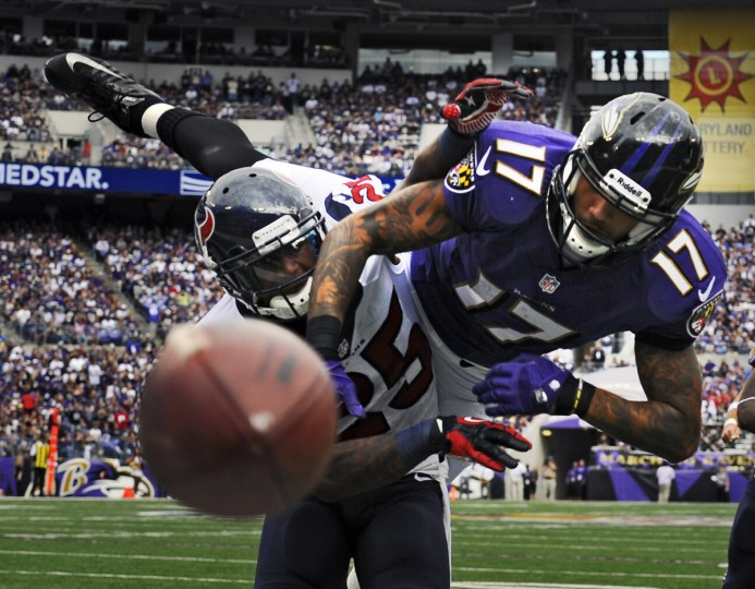 Texans' Kareem Jackson, left, is called for a defensive pass interference on Ravens wide receiver Tandon Doss, right, in the third quarter as the Ravens defeated the Texans by score of 30 to 9 at M& T Bank Stadium on September 22, 2013. (Kenneth K. Lam/Baltimore Sun)