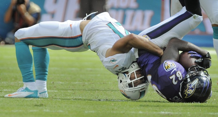 Dolphins' #21 Brent Grimes makes a upside down tackle on Ravens' #82 Torrey Smith after a reception in the second quarter at Sun Life Stadium in Miami, Fla., on October 6, 2013. (Lloyd Fox/Baltimore Sun)