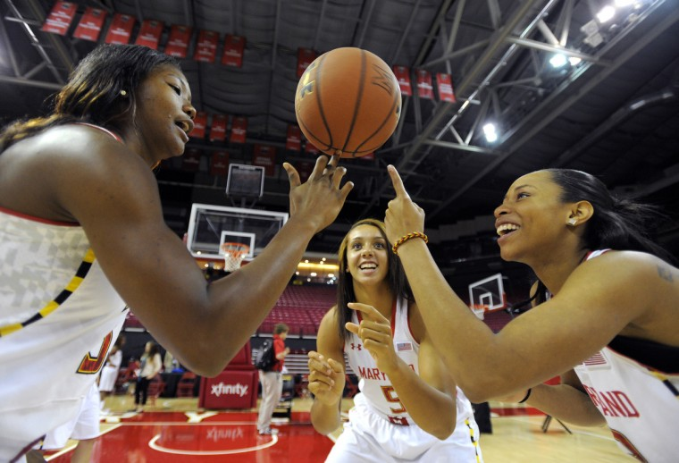 University of Maryland woman's basketball players L-R #33 A'Lexus Harrison, #5 Malina Howard and #3 Brene Moseley try spinning a basketball on their fingers at media day at the Comcast Center on October 9, 2013. (Lloyd Fox/Baltimore Sun)
