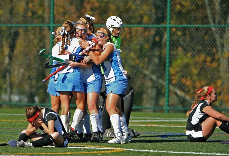 On November 3, 2013, Mount De Sales celebrates as they win their field hockey match with a tie-breaking goal by Mary Kate Halligan as dejected Maryvale players sit nearby. (Amy Davis/Baltimore Sun)