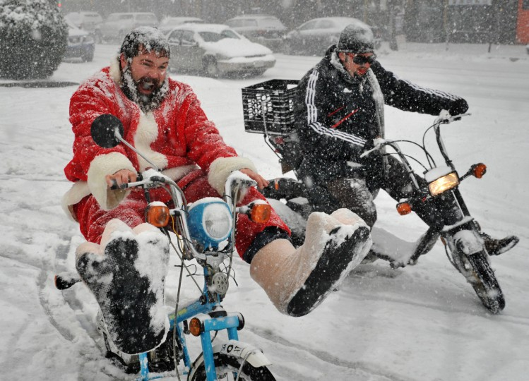 Matt Fouse, left, and friend David Alima, right, held their own Hampden Christmas parade on 36th Street on December 8, 2013, despite the cancellation of the official event. They were doing some extra spins in the parking lot of the 7-11 near Falls Road. (Amy Davis/Baltimore Sun)