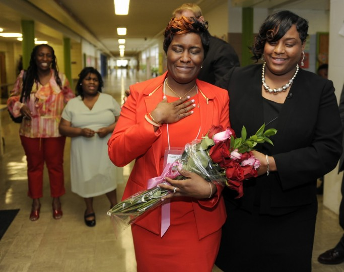 Ketia Chantrese Stokes, center, a special education teacher at Green Street Academy, is named Baltimore City Teacher of the Year. Here, she walks through a hall with school principal Crystal Lindsey, right, after being surprised by the announcement on April 18, 2013. (Barbara Haddock Taylor/Baltimore Sun)