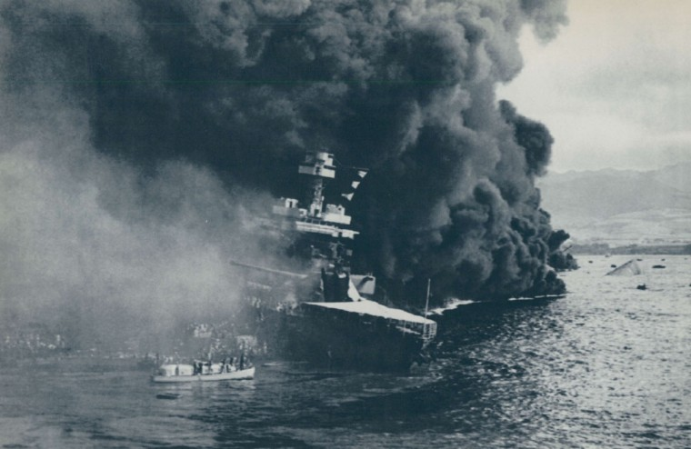 The USS California burns after the attack on Pearl Harbor. This photo shows personnel abandoning ship. (File photo)