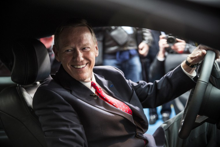 Alan Mulally, CEO of Ford, poses inside the 2015 Ford Mustang on the set of Good Morning America on December 5, 2013 in New York City. The 2015 model marks the 50th anniversary of the Ford Mustang line. (Andrew Burton/Getty Images)