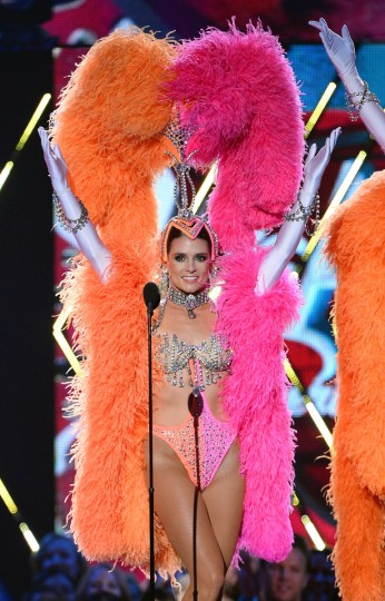 """NASCAR driver Danica Patrick performs dressed as a showgirl from the """"Jubilee!"""" show as she co-hosts the American Country Awards 2013 at the Mandalay Bay Events Center in Las Vegas, Nevada. (Ethan Miller/Getty Images)"""