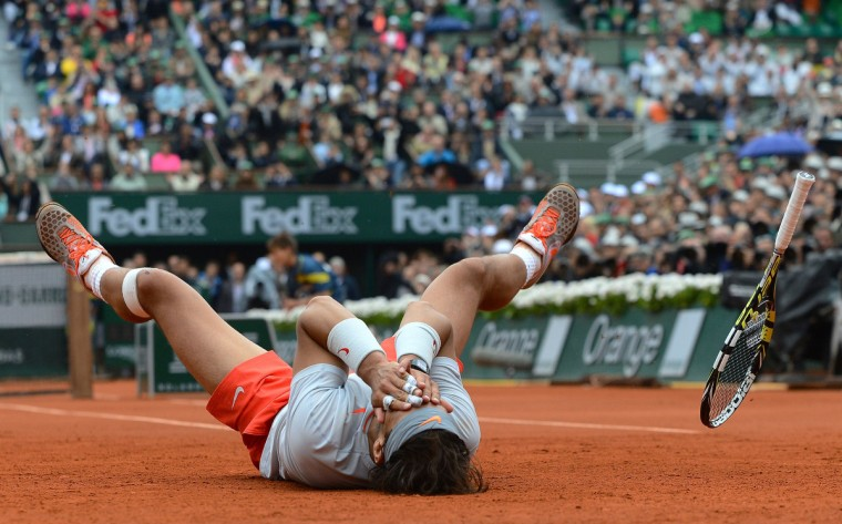 Spain's Rafael Nadal celebrates as he wins the 2013 French tennis Open final against Spain's David Ferrer at the Roland Garros stadium in Paris on June 9, 2013. (Alexis Reau/Getty Images)