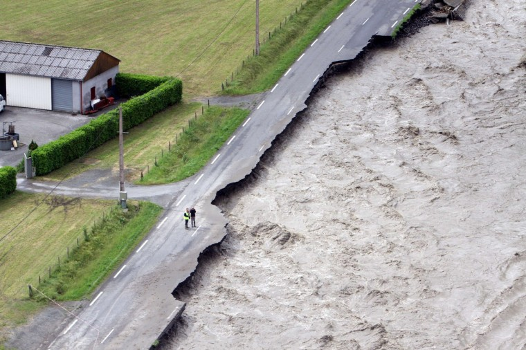 Aerial picture taken on June 19, 2013 in Villelongue shows the flooded Gave de Pau river one day after unseasonal storms caused havoc across huge swaths of the country. (Laurent Dard/Getty Images)