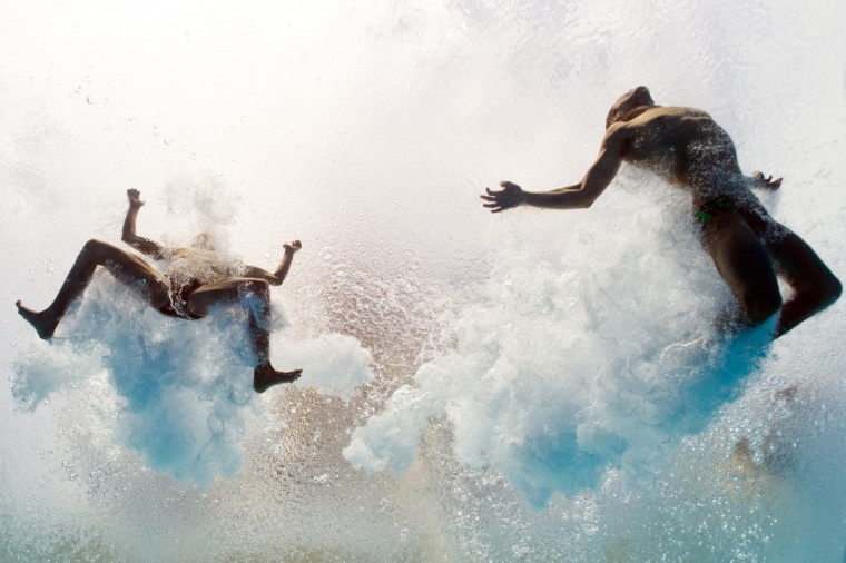 In a picture taken with an underwater camera Mexico's Ivan Garcia and German Sanchez enter the water as they compete in the men's 10-metre synchro platform preliminary diving event in the FINA World Championships at the Piscina Municipal de Montjuic in Barcelona on July 21, 2013. (Francois Xavier Marit/Getty Images)