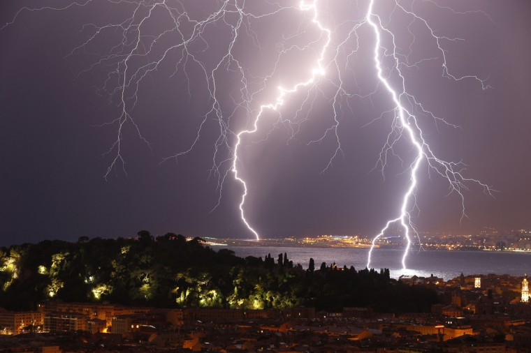 """Flashes of lightning strike above the """"Baie des Anges"""", on October 4, 2013, in Nice, southeastern France. (Valery Hache/Getty Images)"""