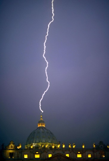 A lightning strikes St Peter's dome at the Vatican on February 11, 2013. Pope Benedict XVI announced today he will resign as leader of the world's 1.1 billion Catholics on February 28 because his age prevented him from carrying out his duties -- an unprecedented move in the modern history of the Catholic Church. (Filippo Monteforte/Getty Images)