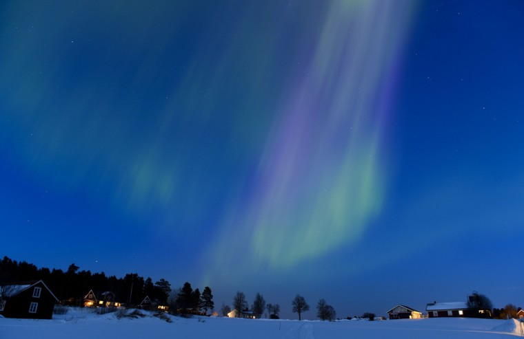 The Aurora Borealis bright up the sky at twilight on March 17, 2013 between the towns of Are and Ostersund, Sweden. (Jonathan Nackstrand/Getty Images)