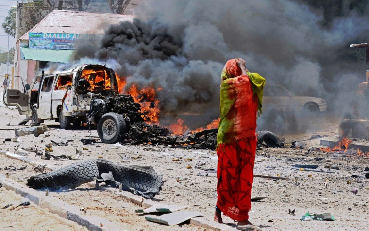 A Somali woman reacts on March 18, 2013 near the site of a car bomb in central Mogadishu. At least eight people were killed on March 18 by a car bomb in central Mogadishu in one of the bloodiest attacks in the war-ravaged capital in recent months, police said. (Mohamed Abdiwahab/Getty Images)