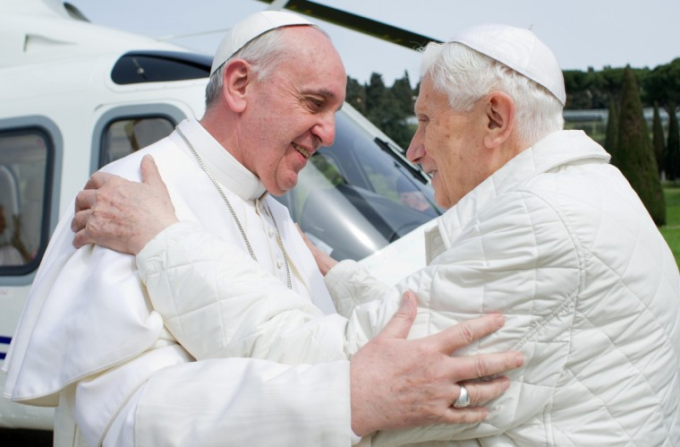 """This handout picture released by the Vatican press office on March 23, 2013 shows """"pope emeritus"""" Benedict XVI (R) greeting Pope Francis upon his arrival at the heliport in Castel Gandolfo. Pope Francis prepared to go face to face with his predecessor Benedict XVI on Saturday in a historic meeting between two men with very different styles but important core similarities. (Getty Images)"""