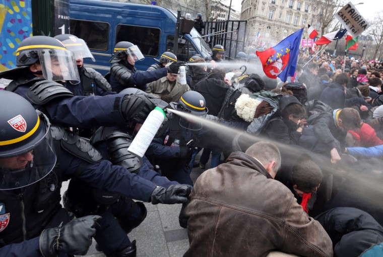 Riot police spray teargas on demonstrators during clashes on the Champs-Elysees avenue in Paris, on March 24, 2013, as thousands of people demonstrated against France's gay marriage law in an attempt to block legislation that will allow homosexual couples to marry and adopt children. (Thomas Samson/Getty Images)
