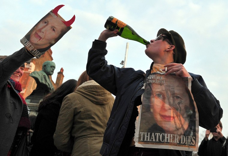 "People gather during a 'party' to celebrate the death of former British Prime Minister Margaret Thatcher in London, on April 8, 2013. Margaret Thatcher, the ""Iron Lady"" who shaped a generation of British politics, died following a stroke on Monday at the age of 87, her spokesman said. (Carl Court/Getty Images)"
