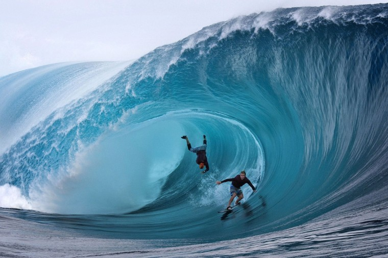 US Garrett McNamara (L) and US Mark Healey (R) compete during a free session of surf tow in, in the southern Pacific ocean island of Tahiti, French Polynesia, on June 1, 2013 in Teahupoo. (Gregory Boissy/Getty Images)