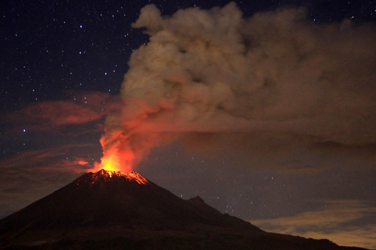 Ash spew from Mexico's Popocatepetl volcano, some 55 km from Mexico City, as seen from San Mateo Ozolco, in the Mexican central state of Puebla, on July 4, 2013. (Pablo Spencer/Getty Images)
