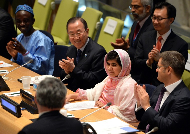 """Pakistani student Malala Yousafzai (2nd R) is greeted by United Nations Secretary General Ban Ki-Moon (2nd L), Vuk Jeremic (R), President of the UN General Assembly, and Gordon Brown (L, back to camera), United Nations Special Envoy for Global Education July 12, 2013 at UN headquarters in New York during the UN Youth Assembly. Yousafzai became a public figure when she was shot by the Taliban while traveling to school last year in Pakistan -- targeted because of her committed campaigning for the right of all girls to an education. The UN has declared July 12 """"Malala Day"""", which is also Yousafzai's birthday, and will host the UN Youth Assembly. (Stan Honda/Getty Images)"""
