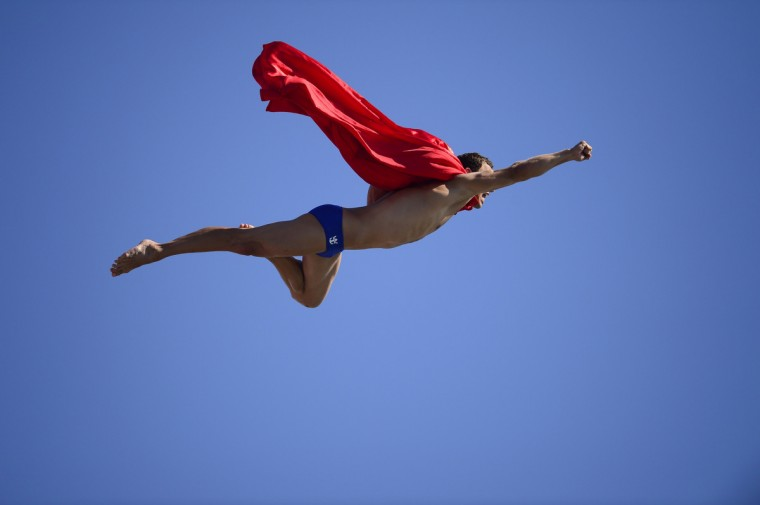 Czech Michal Navratil dives for a joke as superman after of the men's high diving final competition at the FINA World Championships in Moll de la Fusta port in Barcelona on July 31, 2013. (Javier Soriano/Getty Images)