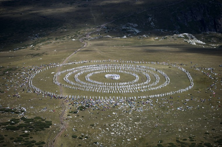Members of an international religious movement called the White Brotherhood perform ritual dances on the top of the Rila Mountain, near Babreka lake, on August 19, 2013. The teaching of the movement, whose founder is Bulgarian Peter Deunov, combines aspects of Christianity and Hinduism with a heavy emphasis on brotherly love, a healthy diet and living in harmony with nature. (Dimitar Dilkoff/Getty Images)