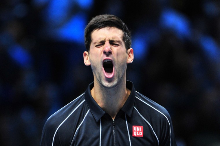 Serbia's Novak Djokovic celebrates winning a game on the way to winning the first set against Spain's Rafael Nadal during the singles final on the eighth day of the ATP World Tour Finals tennis tournament in London on November 11, 2013. (Glyn Kirk/Getty Images)