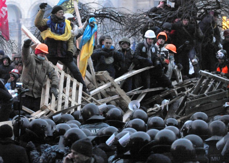 Anti-Yanukovych protesters defend their barricades in front of anti-riot police on Independence Square in Kiev, early. Ukrainian security forces pulled out of the epicentre of mass protests in Kiev today after a nine hour standoff with thousands of demonstrators, in a major boost for the opposition to President Viktor Yanukovych. (Viktor Drachev/Getty Images)