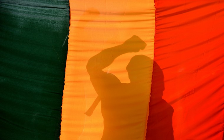 An Indian gay-rights activist gestures behind a flag during a protest against the Supreme Court ruling reinstating a ban on gay sex in Bangalore. India's Supreme Court reinstated a colonial-era ban on gay sex on that could see homosexuals jailed for up to ten years in a major setback for rights campaigners in the world's biggest democracy. (Manjunath Kiran/Getty Images)