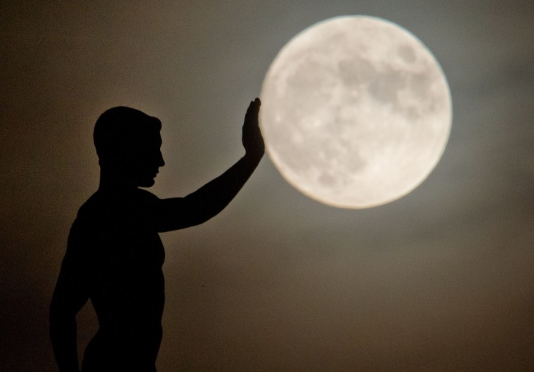 A sculpture is silhouetted against the full moon in Hanover, central Germany. (Julian Stratenschulte/Getty Images)