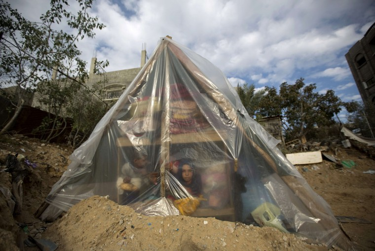 A Palestinian family sits in a tent after their house was flooded following a huge storms across the Levant that left the Gaza Strip under flood waters in Beit Lahia in the northern Gaza Strip. (Mohammed Abed/Getty Images)