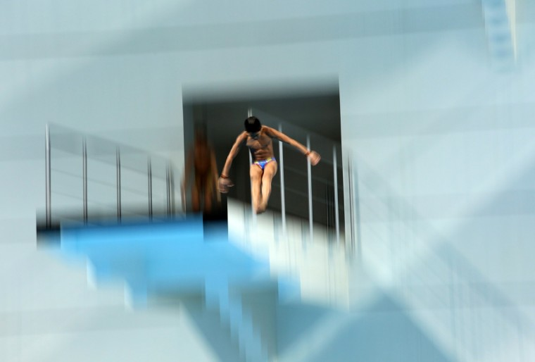 Malaysia's Abdullah Muhammad Nazreer competes during the men's 10m platform diving event at the 27th SEA Games in Naypyidaw. (Ye Aung Thu/Getty Images)