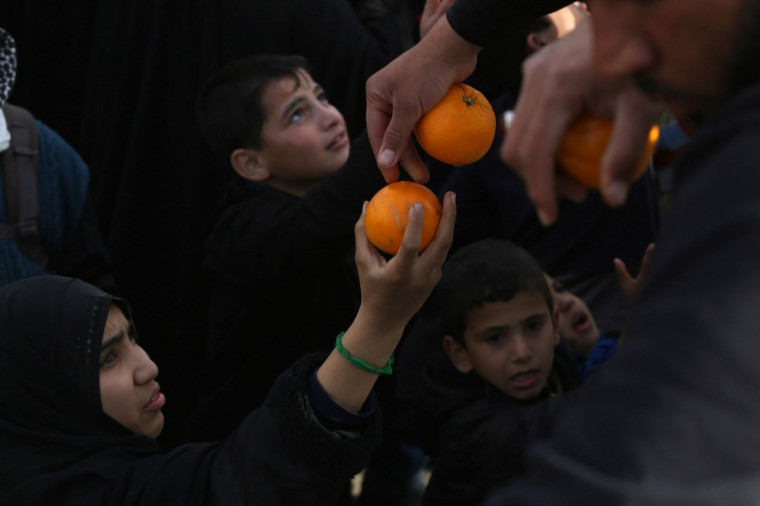 Oranges are distributed to Iraqi Shiite Muslim pilgrims as they walk along the main highway from Najaf to the central shrine city of Karbala, to take part in the Arbaeen religious festival which marks the 40th day after Ashura commemorating the seventh century killing of Prophet Mohammed's grandson, Imam Hussein. (Mohammed Sawaf/Getty Images)