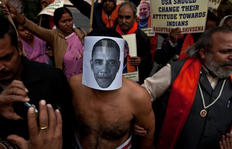 A right-wing Indian Hindu activist wearing a mask depicting US President Barack Obama takes part in a protest near the US Embassy in New Delhi. India vowed Wednesday to bring one of its diplomats home at any price after her arrest in New York, as she told how she broke down in tears after being stripped and cavity-searched. (Manan Vatsyayana/Getty Images)
