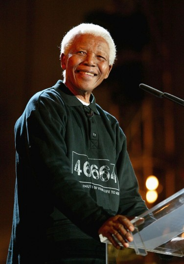 "Nelson Mandela makes a speech at the ""46664 - Give One Minute of Your Life to AIDS"" concert at Greenpoint Stadium on November 29, 2003 in Cape Town, South Africa. The concert will benefit the Nelson Mandela Foundation and the fight against AIDS in Africa. (Frank Micelotta/Getty Images)"